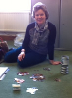 Liz, counting the first full collection tin